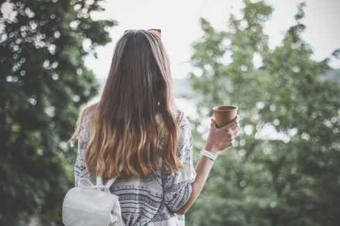 walking girl with coffee